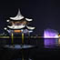 Tourists view night scene of West Lake in Hangzhou