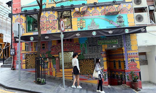 Tourists tour streets in China's Hong Kong
