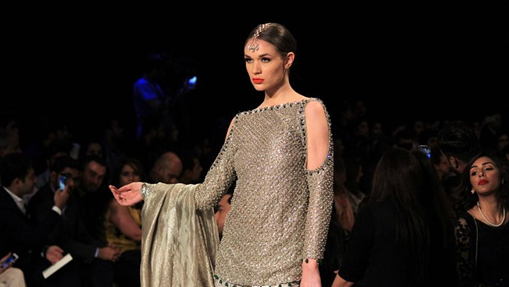 Models present creations during PFDC Bridal Fashion Week in Lahore