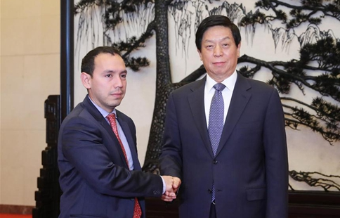 China's top legislator meets delegation of Colombian political party