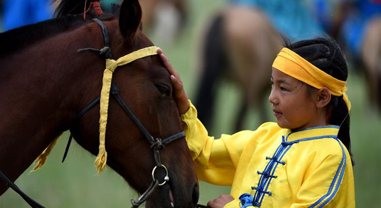 Pic story of 10-year-old well-known jockey in China's Inner Mongolia