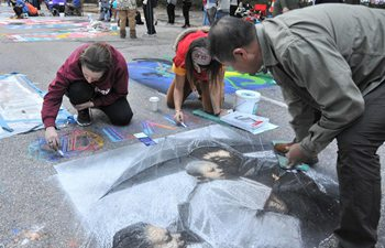 Over 200 worldwide artists make street painting in Houston